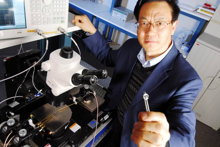 Zhong Lin Wang holds a prototype direct current (DC) power piezoelectric nanogenerator (NG)